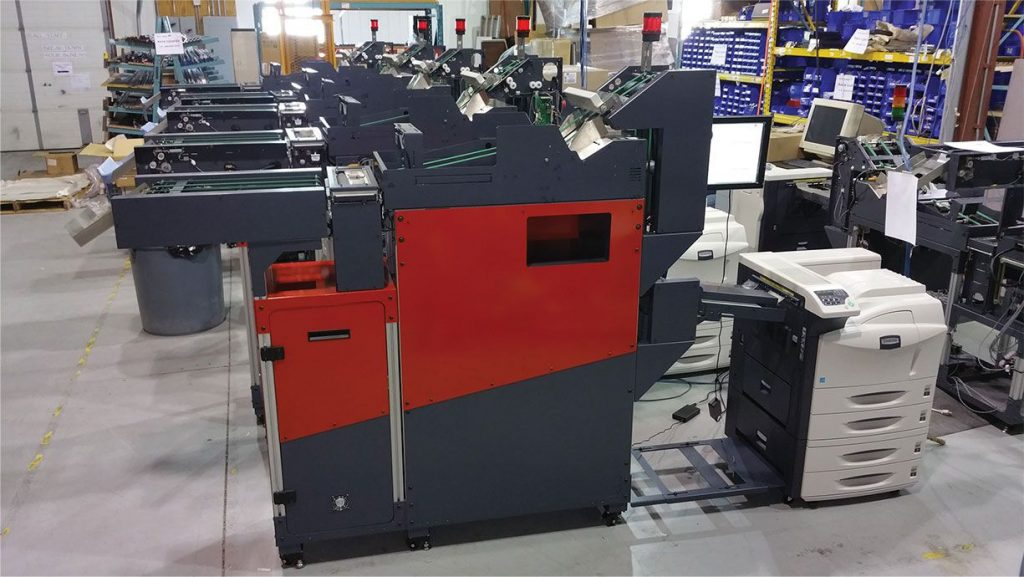 PSI Engineering print feeders for inline document printing, folding and inserting shown in distribution centre