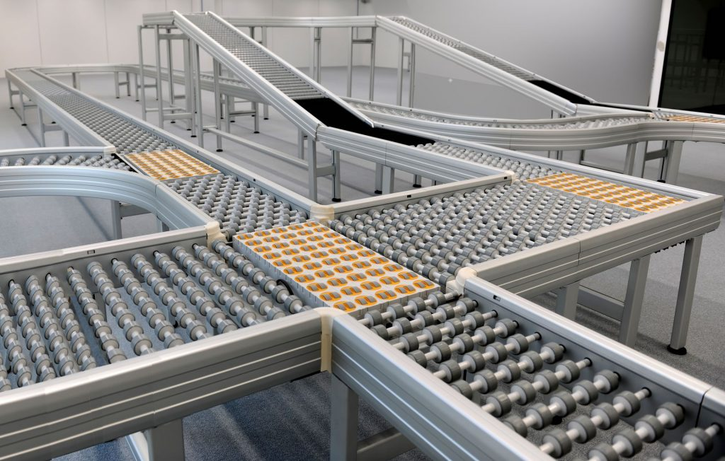 A series of modern Avacon multi-directional zone powered motor conveyors